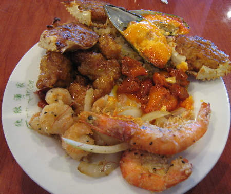 The buffet features several seafood items