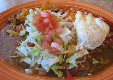 Enchilada plate with a fried egg atop