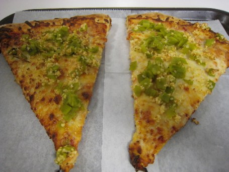 Two slices of garlic and green chile pizza