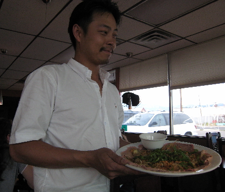 Proprietor James Nguyen with a plate of lime beef