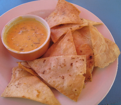 Blue crab claw meat Queso served with tortilla chips