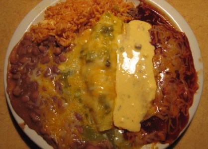 Tres Colores: a red chile enchilada, an enchilada topped with con queso and a green chile enchilada.