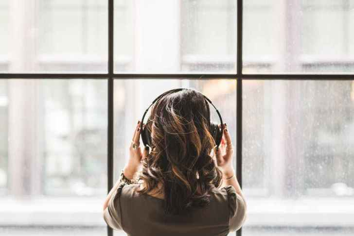 She is listening to Music