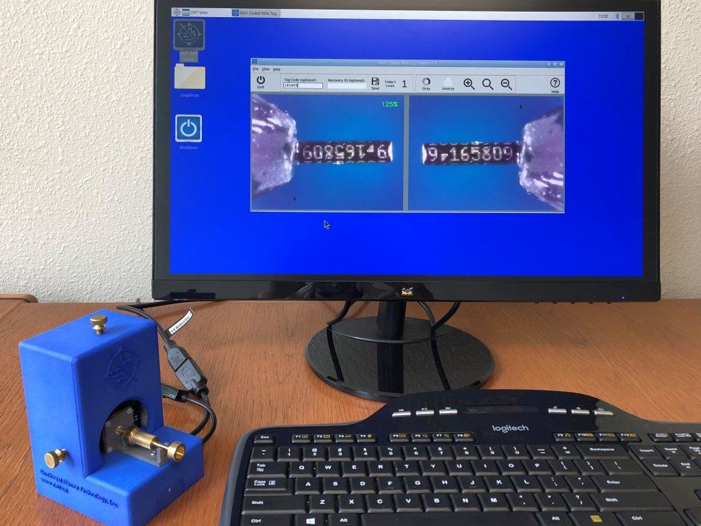 The Tag Viewer includes a monitor, keyboard and mouse. A digital image of the tag is projected on the monitor.