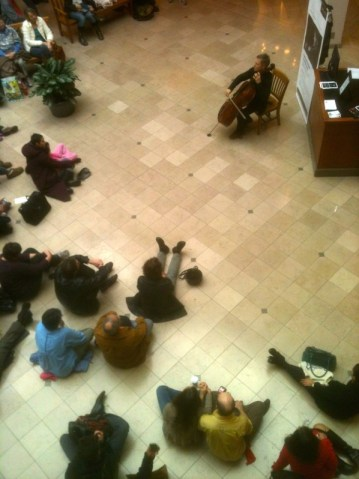 Alban Gerhardt performs Bach at Portland's Pioneer Place mall on Friday. Photo: Charles Noble.
