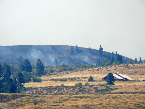 Smoldering fire approaching Signal Hill Ranch. Photo: © Mary Kiesau