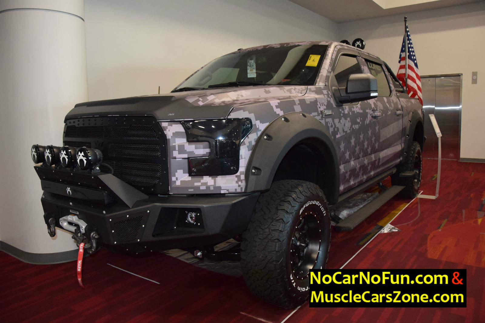 This $1.8 billion automotive plant is one of the most advanced assembly plants in north america. grey-custom-truck-with-american-flag-paint-job-at-sema