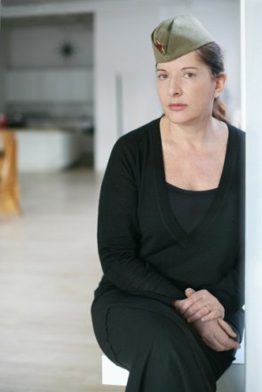 Marina Abramovic in her loft in Manhattan. Se is wearing her mother's partisan hat