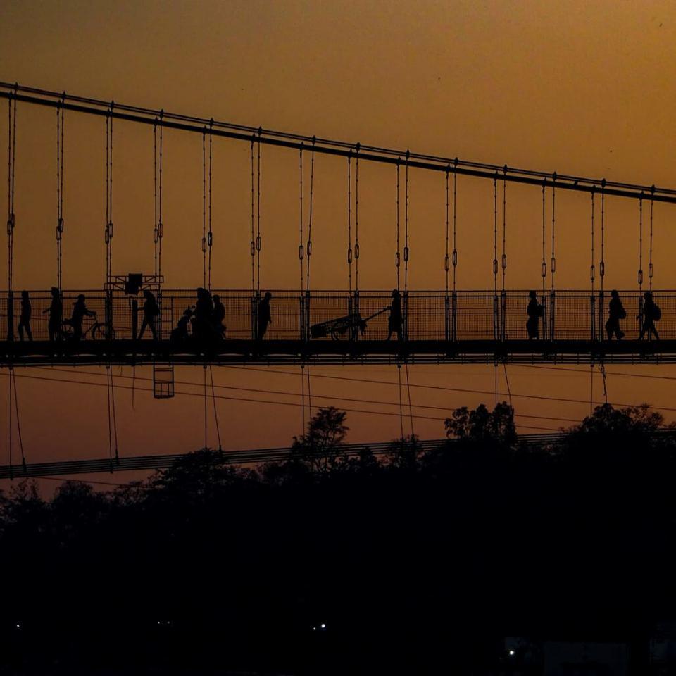 Sunset behind Ram Jula Bridge, Rishikesh