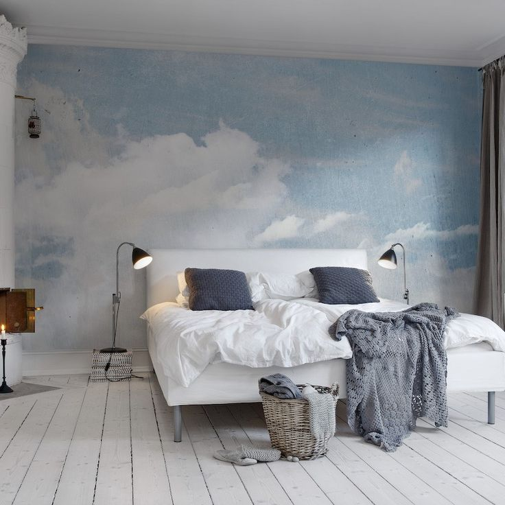 blue-and-white-cloud-wallpaper-behind-a-bed