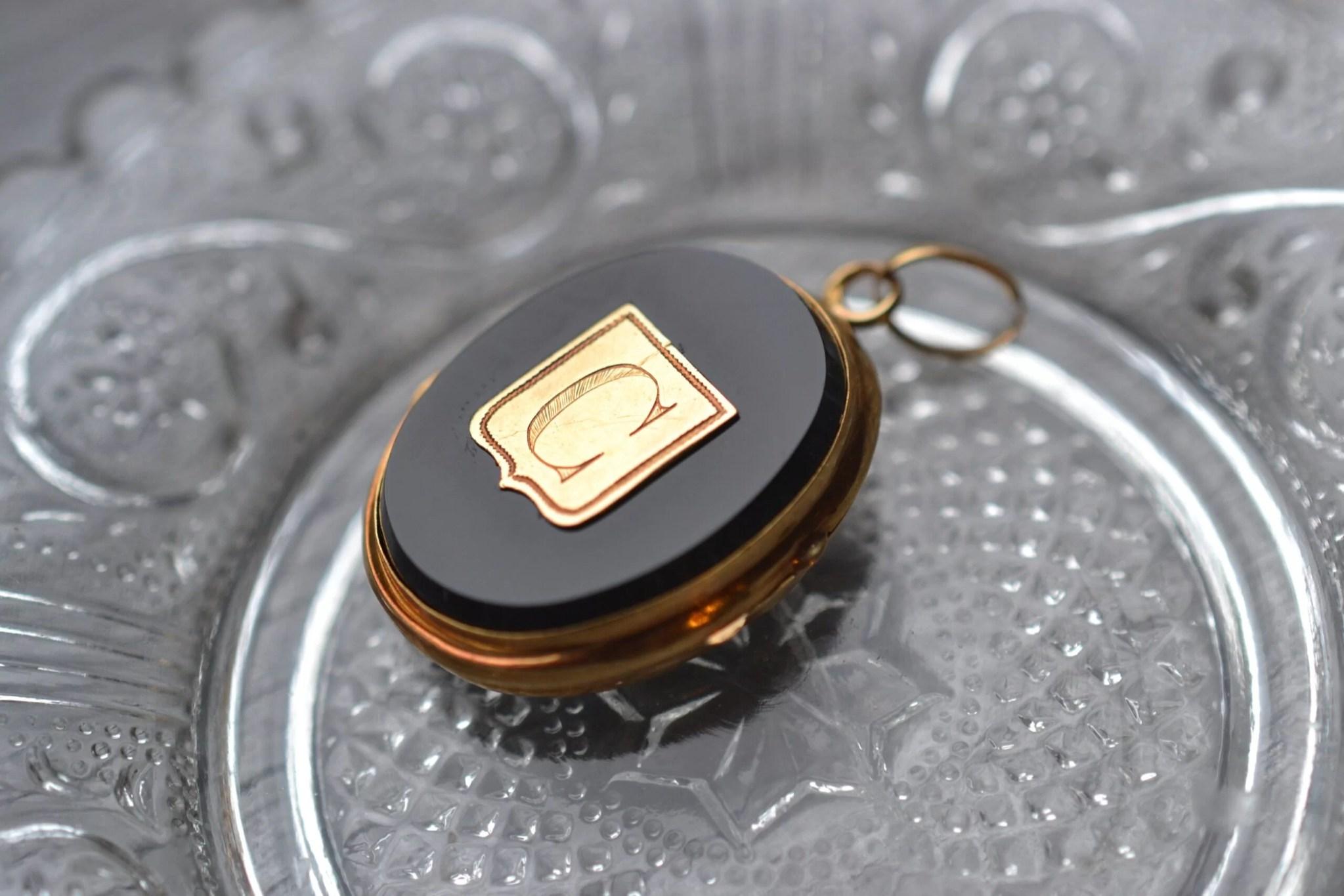 Pendentif porte photo - en onyx et or jaune 18 carats - Bijoux Vintage de seconde main