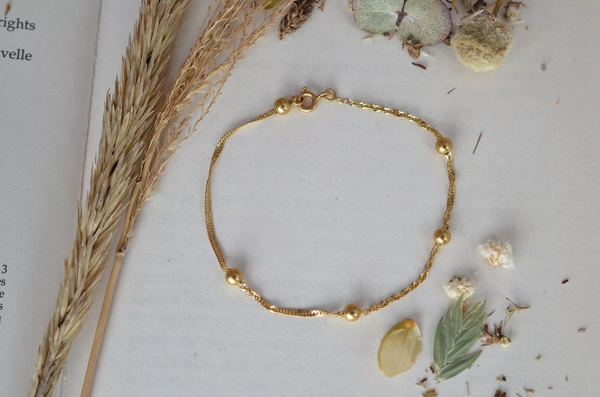 Bracelet en Or jaune décoré de billes, maille effet torsadé - bracelet de seconde main
