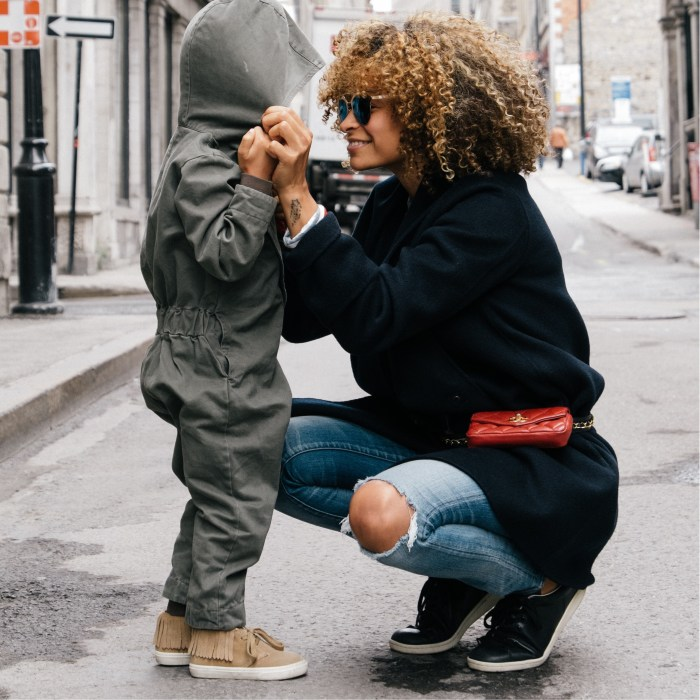 Mixed texture afro hair mother and child in street