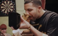 Drake drinks from his Grammy Award