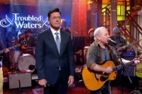 Stephen Colbert performs with Troubled Waters