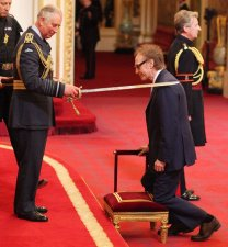 Prince Charles knights Sir Ray Davies