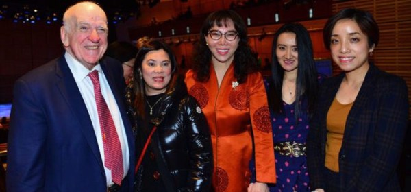 Charles W. Sullivan and Lily Li with guests at the Chinese New Year Spectacular IV