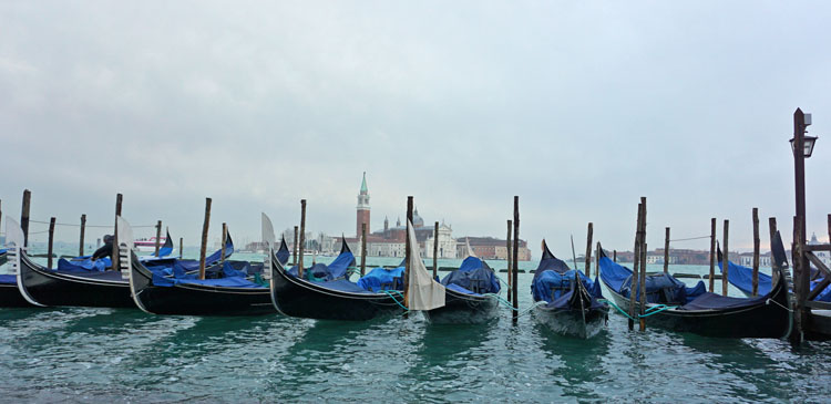 Gondolas tied up in one of Venice's canals
