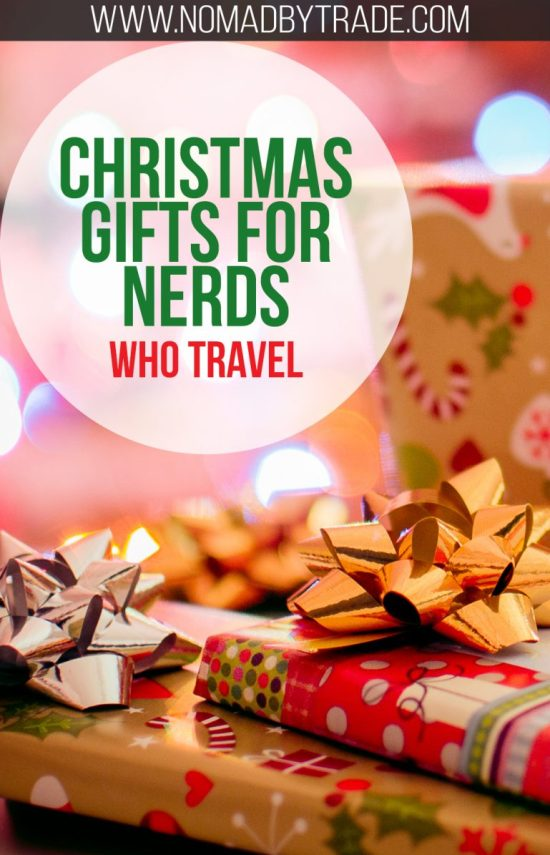 "Wrapped Christmas presents with text overlay reading ""Christmas gifts for nerds who travel"""