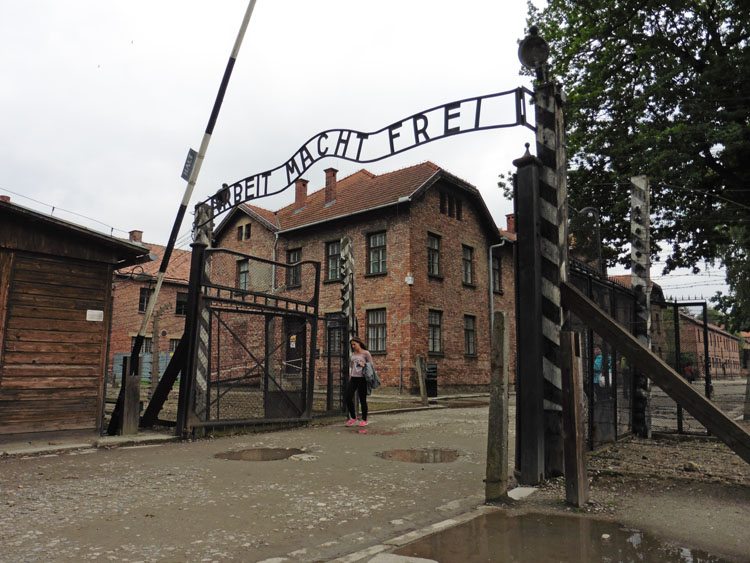 "Entrance to Auschwitz with ""Arbeit macht frei"" sign"