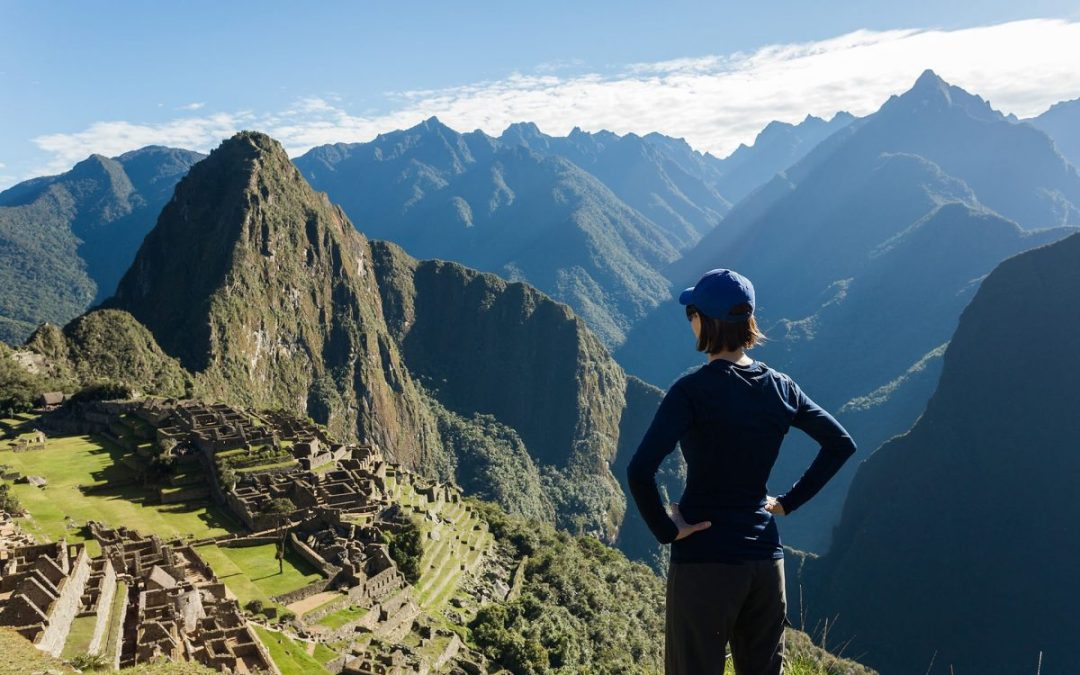 Hiker looking at Machu Picchu, one of the best Peru hikes