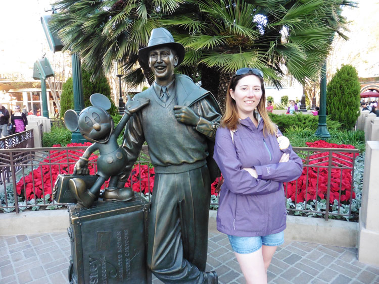 Woman posing with statue at California Adventure