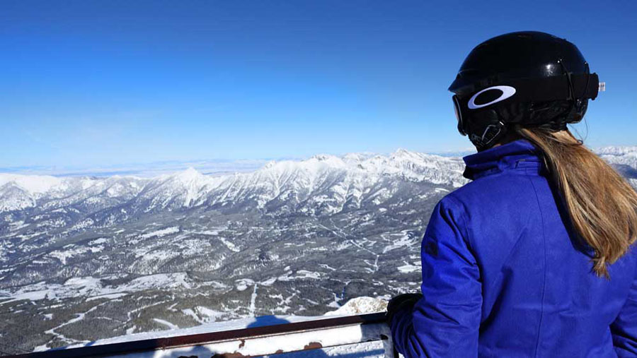 Skier overlooking the mountain at the Big Sky Ski Resort in Montana