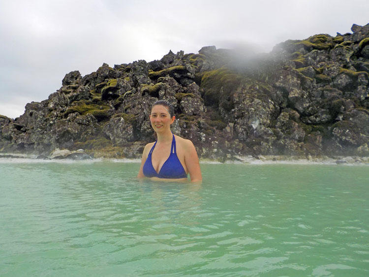 Woman posing in the Blue Lagoon, one of the top attractions in Iceland