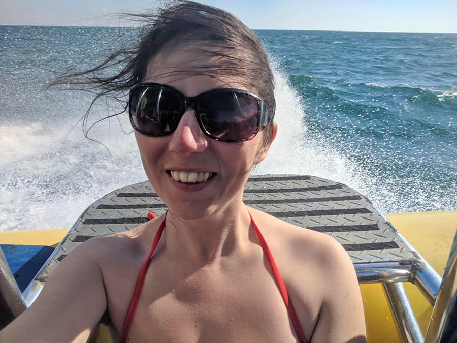 Woman with windblown hair on a boat
