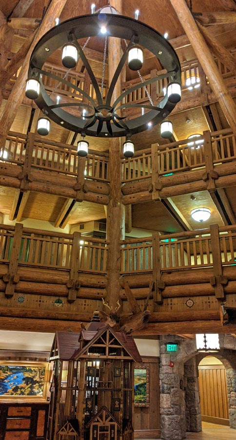 High-ceilinged lobby with wooden beams and a chandelier at the Wilderness Lodge DVC entrance