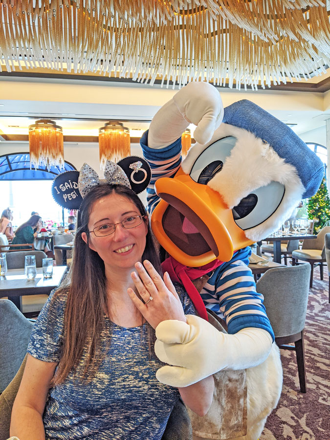 Woman posing with Donald at Topolino's Terrace character breakfast