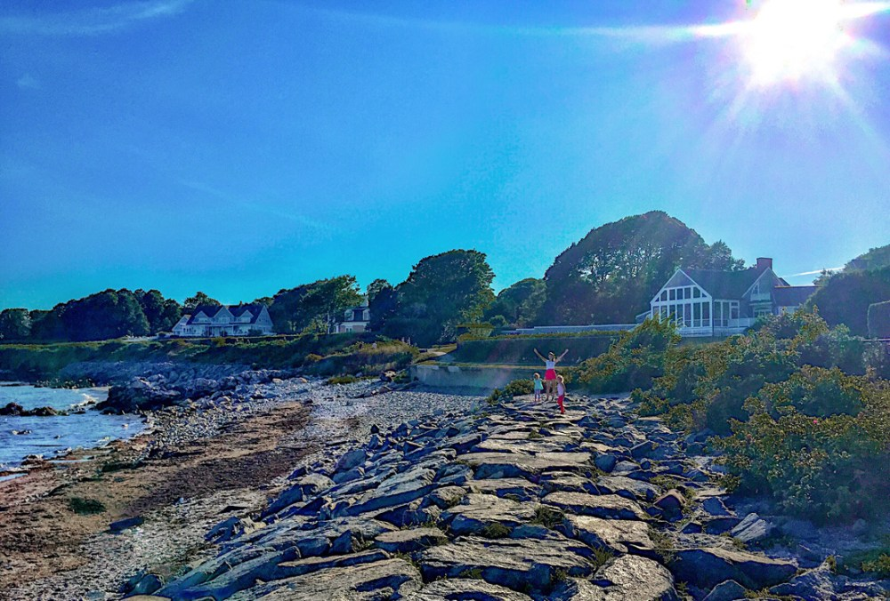 Rocky shore and mansions along the Cliff Walk in Newport, Rhode Island