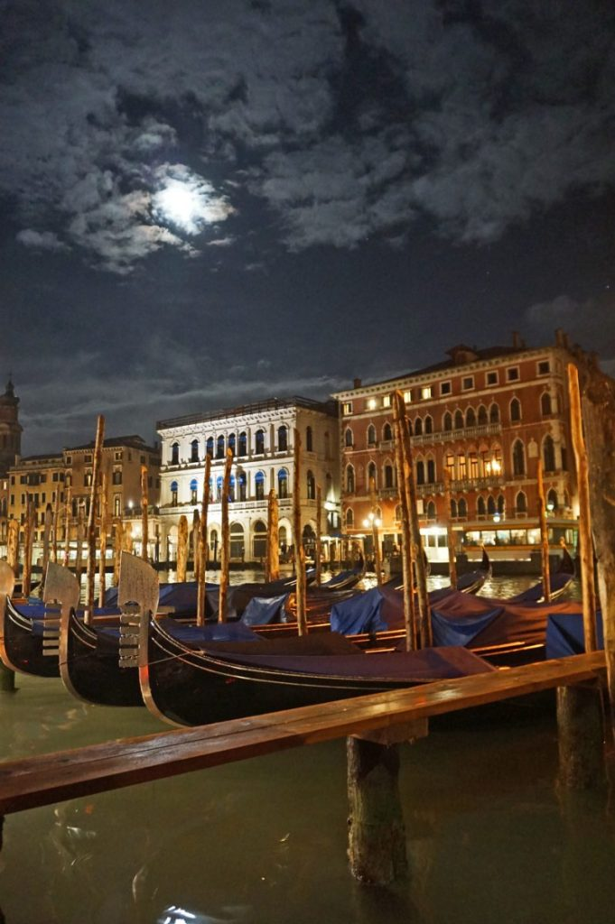 Gondolas line the Grand Canal in Venice at night