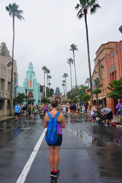 Woman showing off her Disney park bag on a rainy day in Hollywood Studios