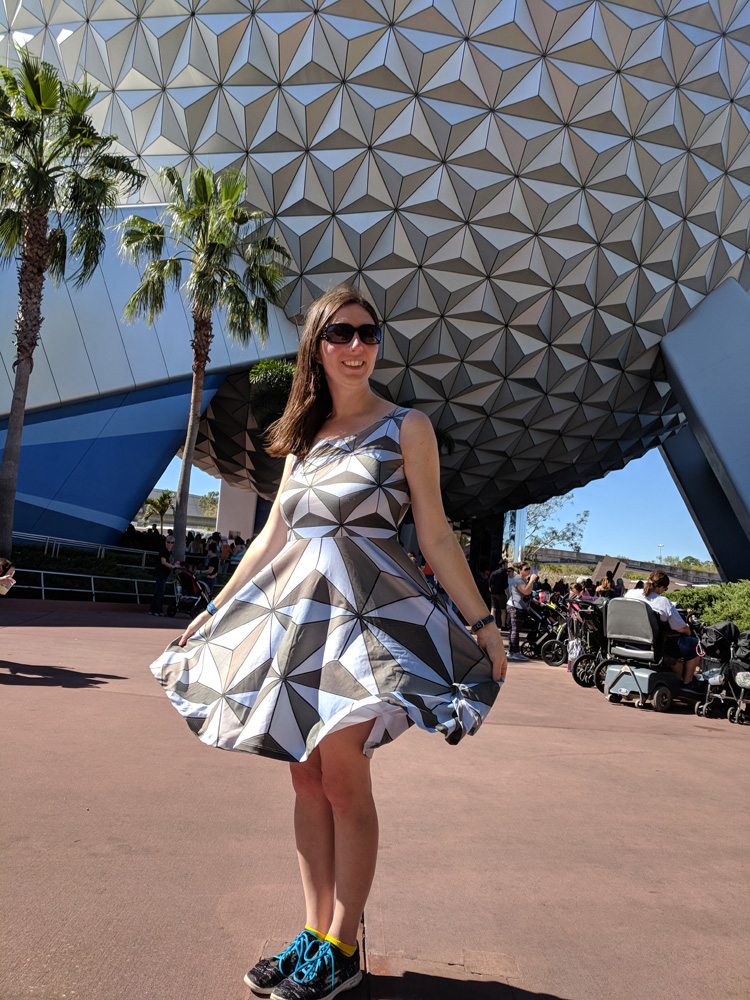 Woman in a Spaceship Earth dress in front of Spaceship Earth