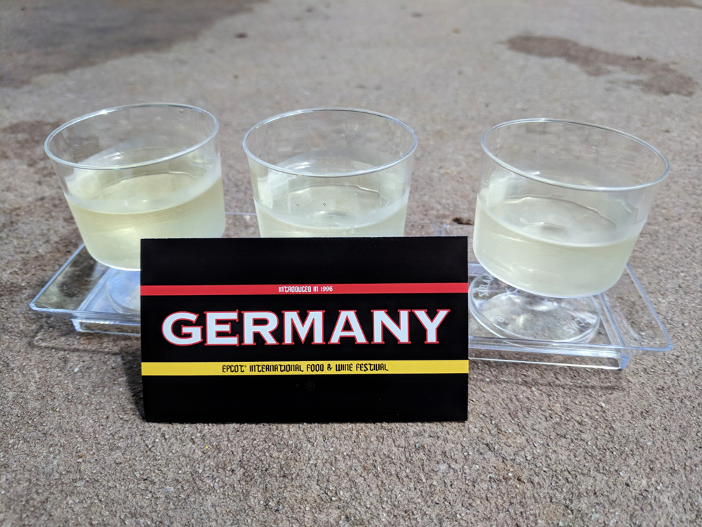Three small pours of white Riesling wine from the Epcot Food and Wine Festival Germany kiosk