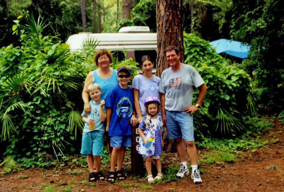 Family at a Fort Wilderness campsite