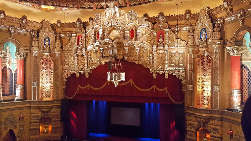 Gilded, ornate decor over a large stage