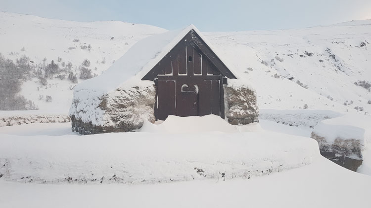 Snow covered cabin on a Game of Thrones tour in Iceland