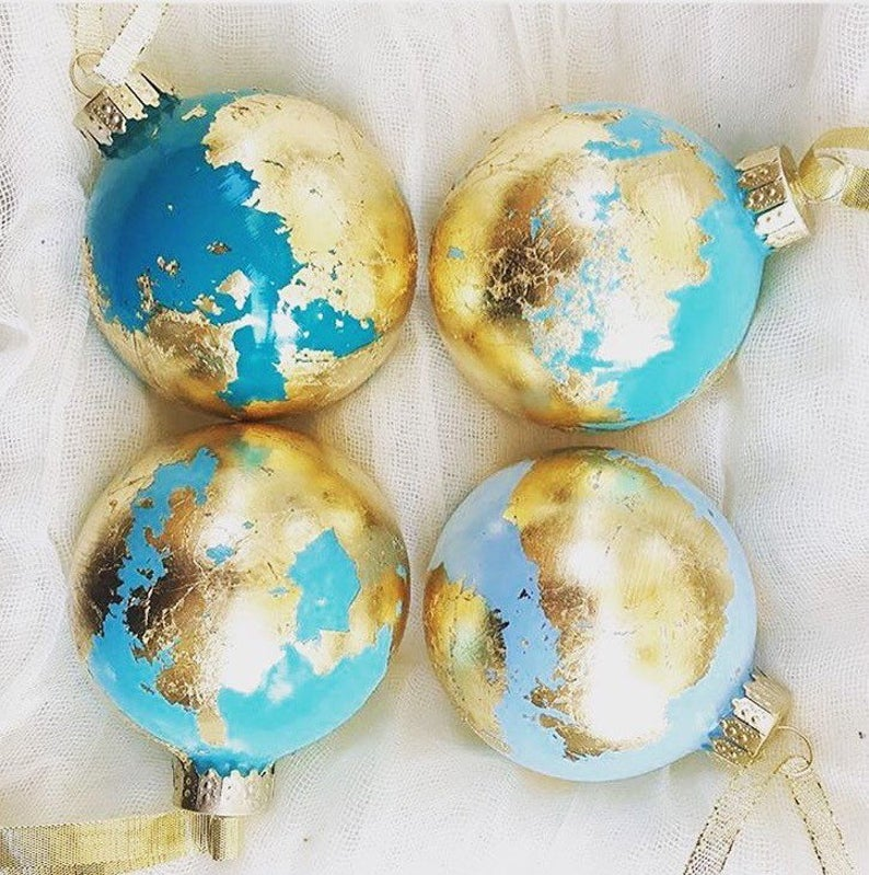 Gilded globe ornaments in various shades of blue