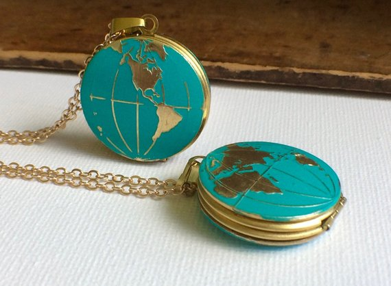 Vintage locket with globes on it