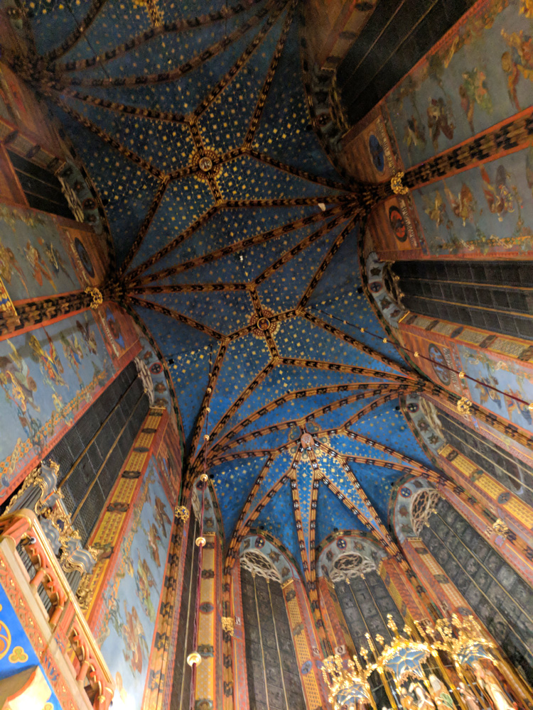 Blue painted ornate ceiling inside St. Mary's Basilica in Krakow, Poland