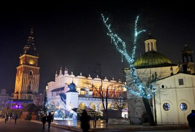 The Krakow Christmas market lit up with twinkling lights at night
