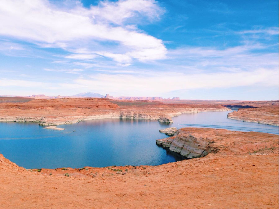 Blue waters of Lake Powell set against red rock