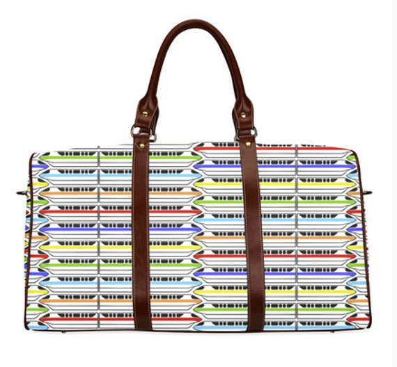 Weekender bag with a Disney World monorail print