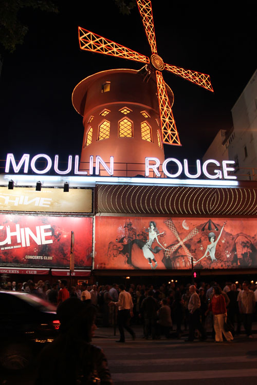 Crowds in front of the Moulin Rouge windmill in Montmartre France