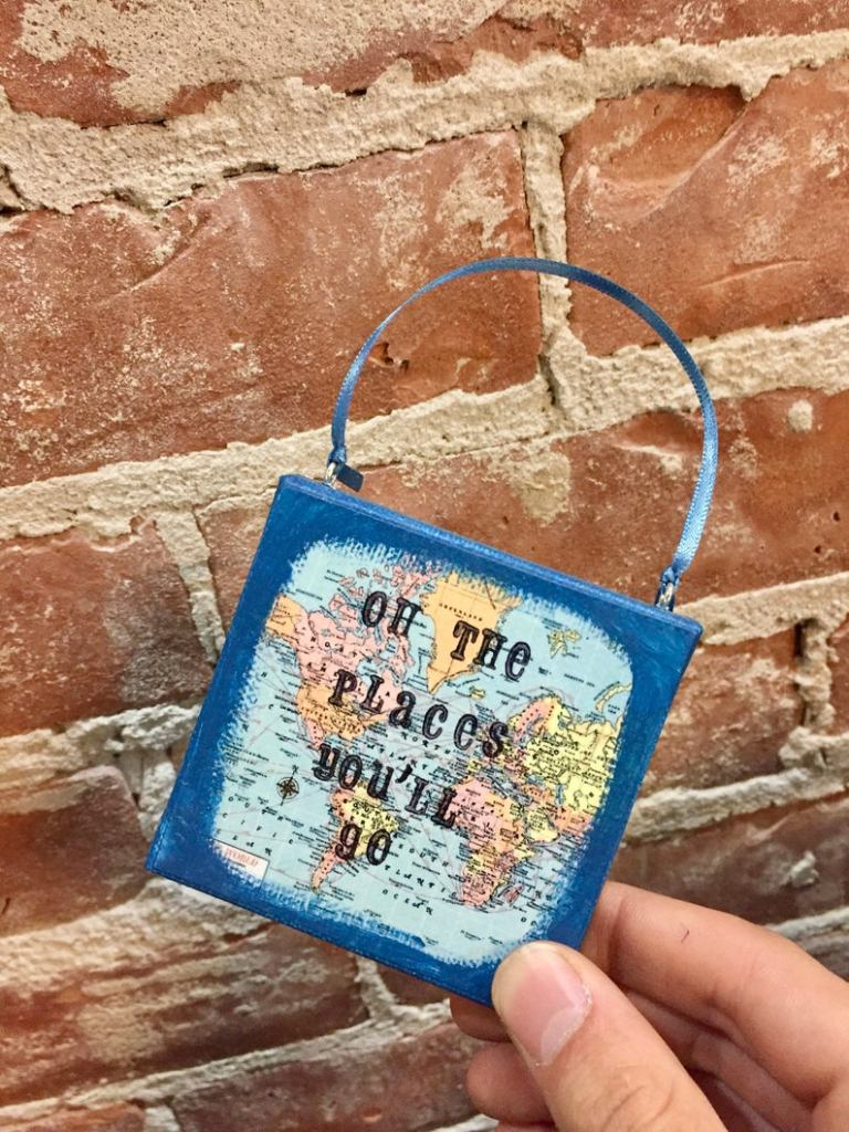 "Map ornament with text reading ""Oh the places you'll go"""