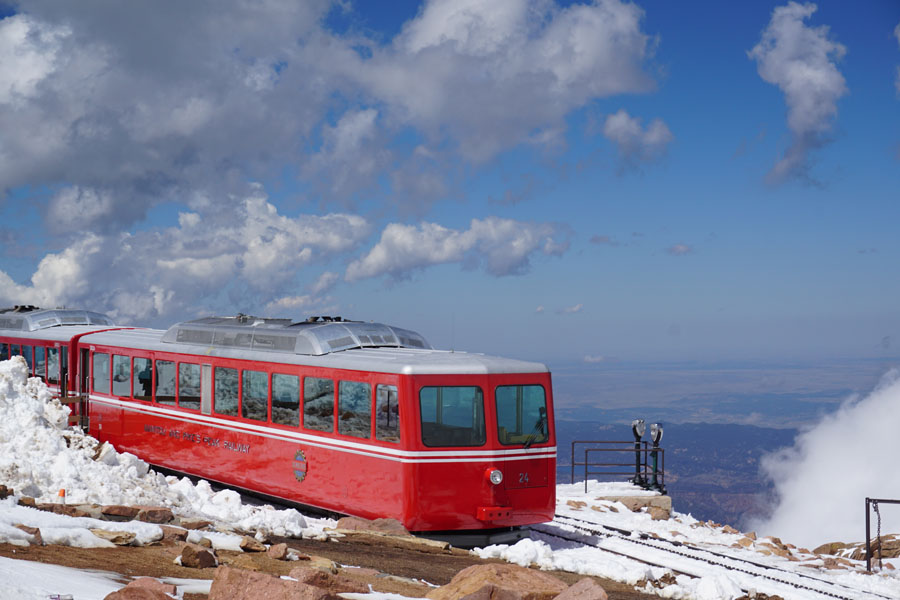 Red inclined railway train atop Pikes Peak