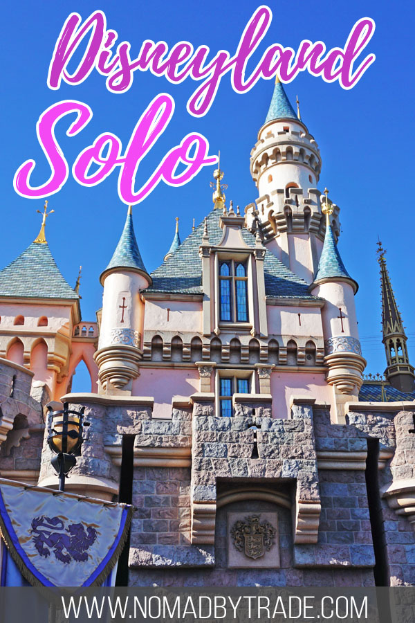 "Sleeping Beauty Castle at Disneyland with text overlay reading ""Disneyland solo"""