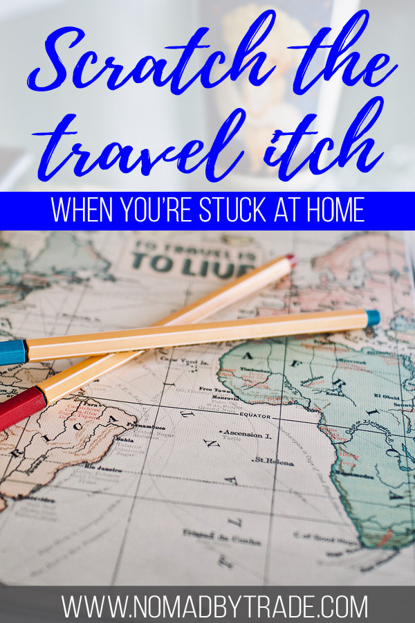 "Photo of a map with text overlay reading ""Scratch the travel itch when you're stuck at home"""